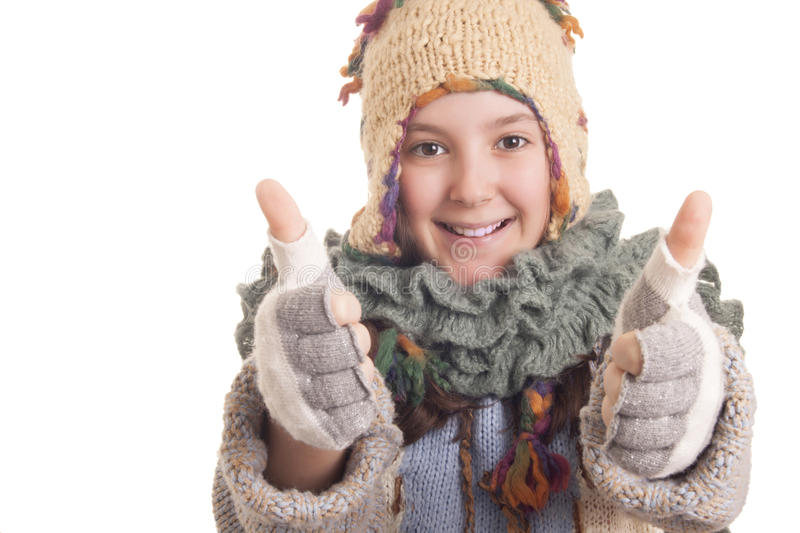 Beautiful young girl in warm winter clothes showing thumbs up stock photos