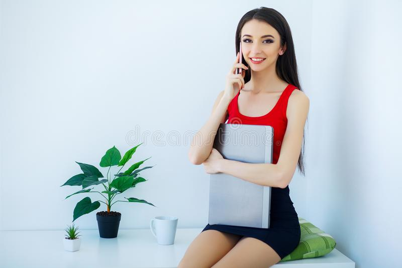 Beautiful young girl working on computer at home royalty free stock image