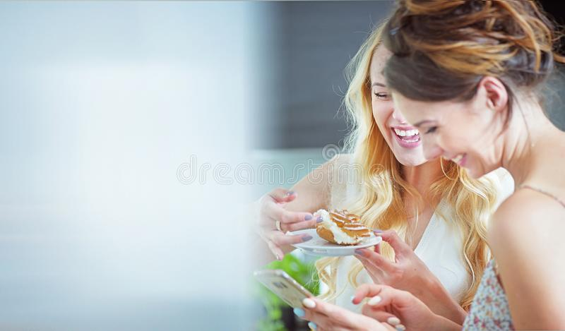 Beautiful girlfreinds enjoying sweets during the summer day royalty free stock images