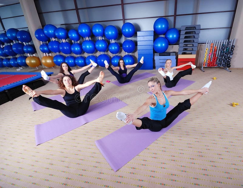 Beautiful young girls working out in a gym stock photos
