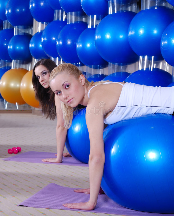 Beautiful young girls working out in a gym royalty free stock image