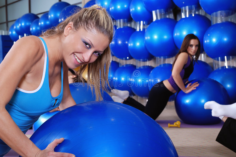 Beautiful young girls working out in a gym stock images