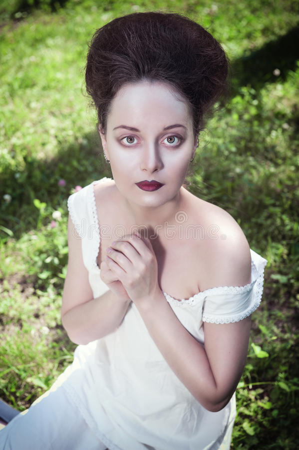Beautiful young gothic woman in white shirt. Outdoor stock photos