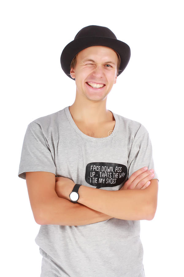 Beautiful young guy in a hat and t-shirt. Young guy in a hat and casual t-shirt half length portrait on white background royalty free stock photography