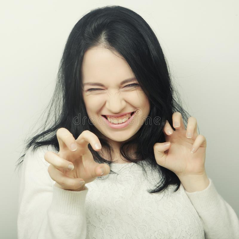 Beautiful young happy brunette woman. Studio shot royalty free stock images