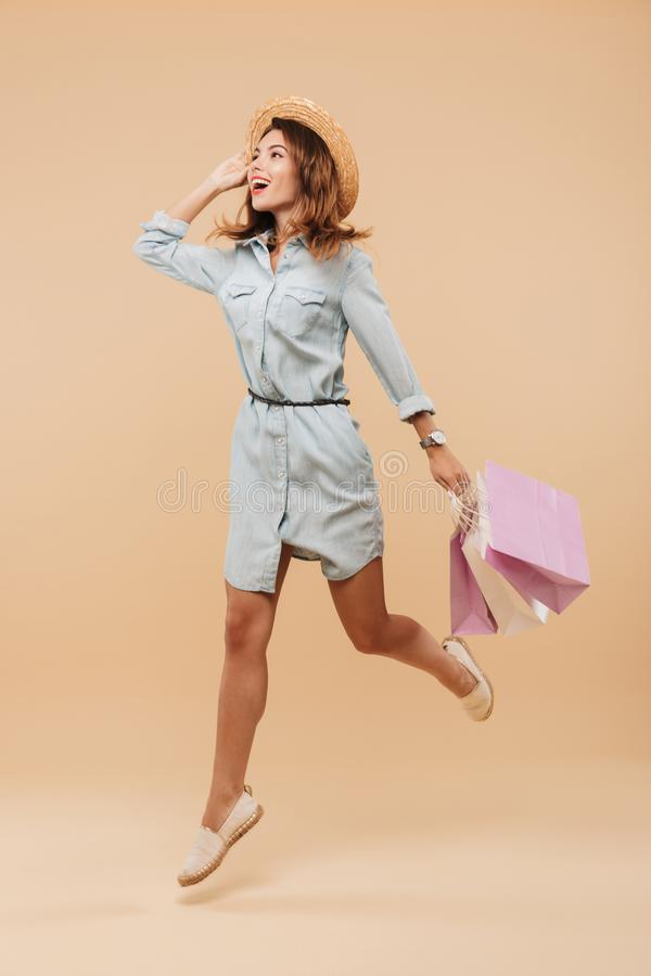 Beautiful young happy woman holding shopping bags stock photos