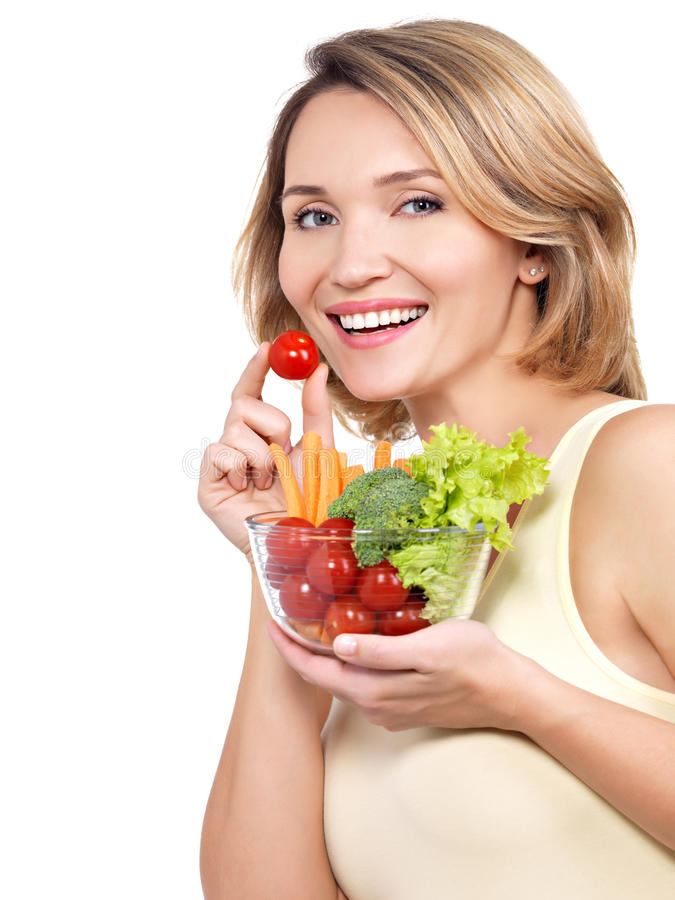 Beautiful young healthy woman with a plate of vegetables. stock photo