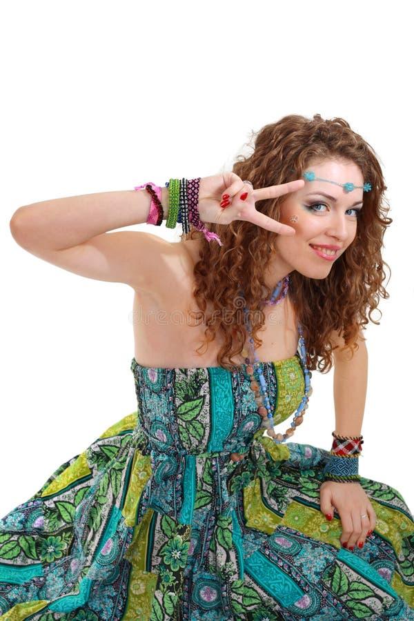 Beautiful young hippie woman in green dress