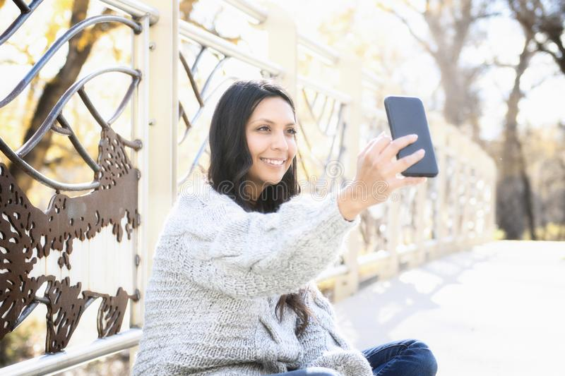 Beautiful Young Hispanic, American Indian, Multi-racial Woman with Cell Phone. Beautiful Young Hispanic, American Indian, Multi-racial Woman Checking Messages & royalty free stock photos