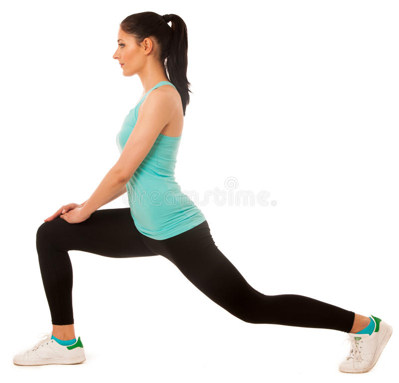 Beautiful young hispanic woman doing lunge exercise in fitness g royalty free stock photos