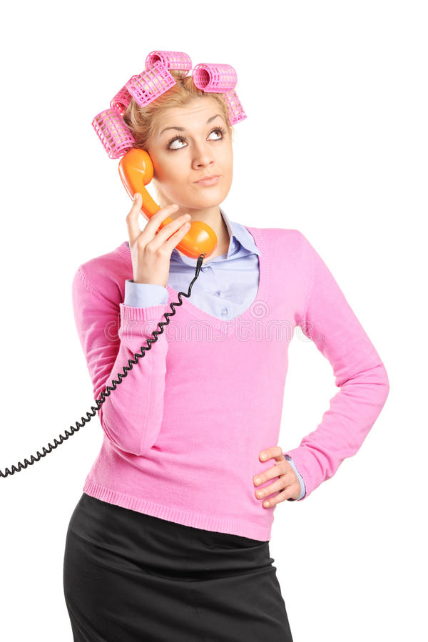 Download Beautiful Young Housewife With Hair Rollers Talking On A Phone Stock Photo - Image: 29564004