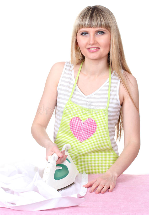 Beautiful young housewife ironing royalty free stock image