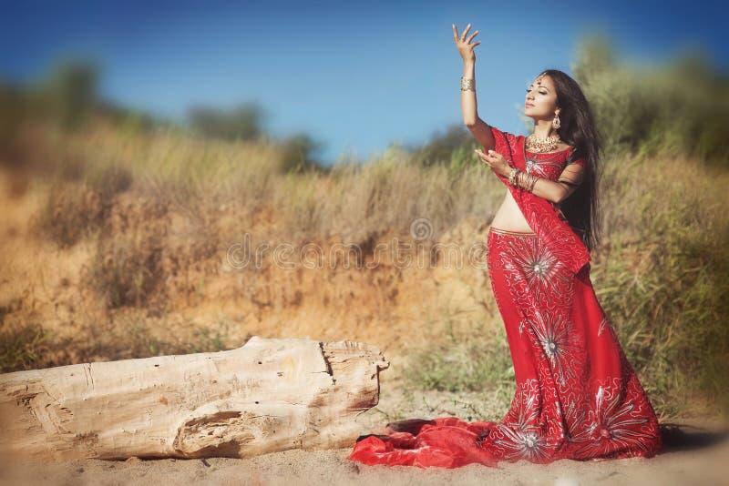 Beautiful Indian woman bellydancer. Arabian bride dancing royalty free stock images