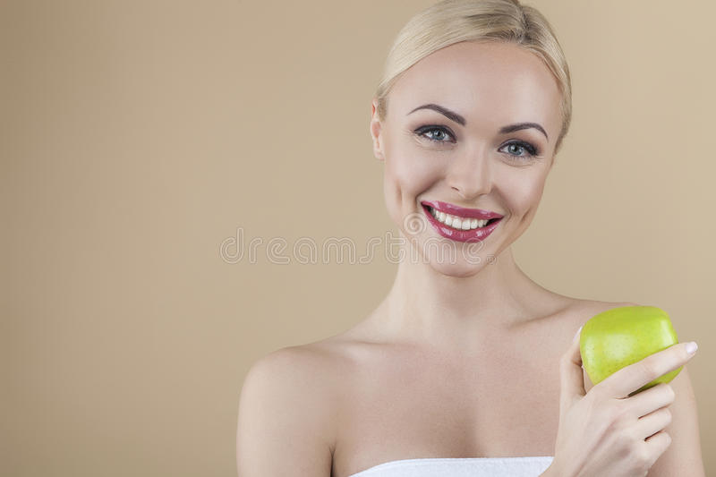 Beautiful young lady with apple royalty free stock photos