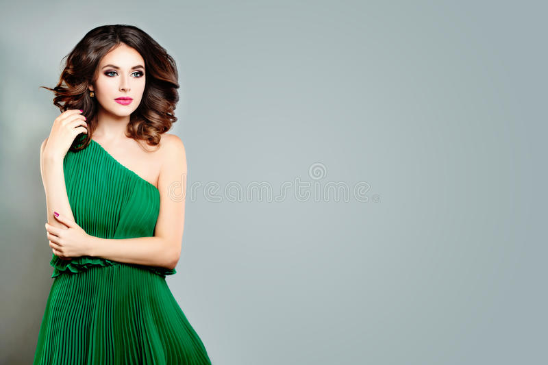 Beautiful Young Lady Fashion Model. Perfect Woman in Green Dress royalty free stock photography