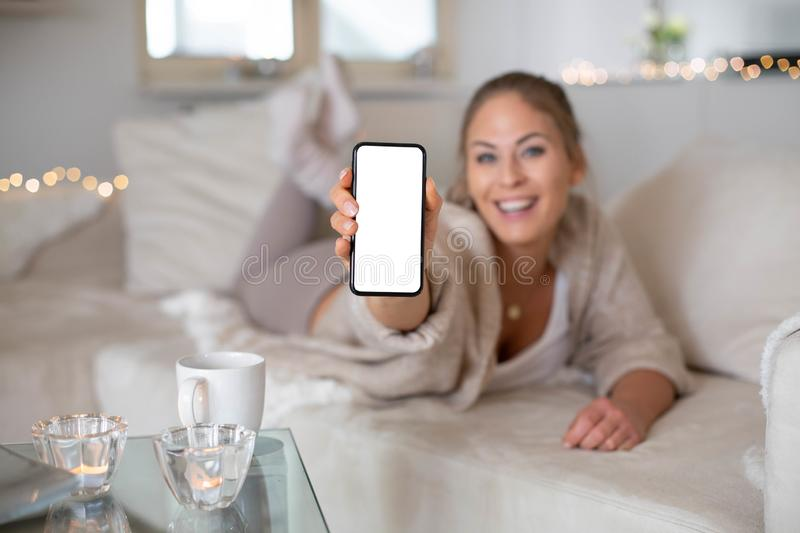 Women is holding a mobile phone stock images