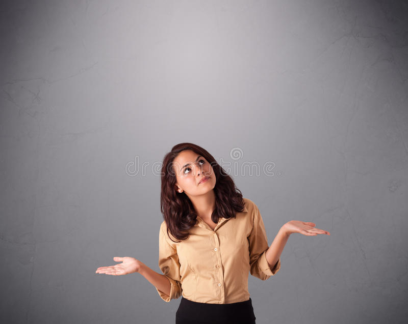 Beautiful young lady juggling with copy space royalty free stock image