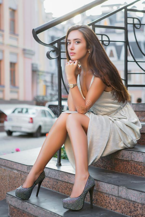 Beautiful young lady posing on the street stock images