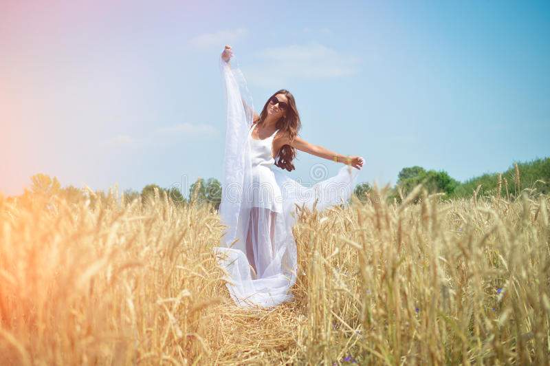 Beautiful young lady in white dress standing on stock images