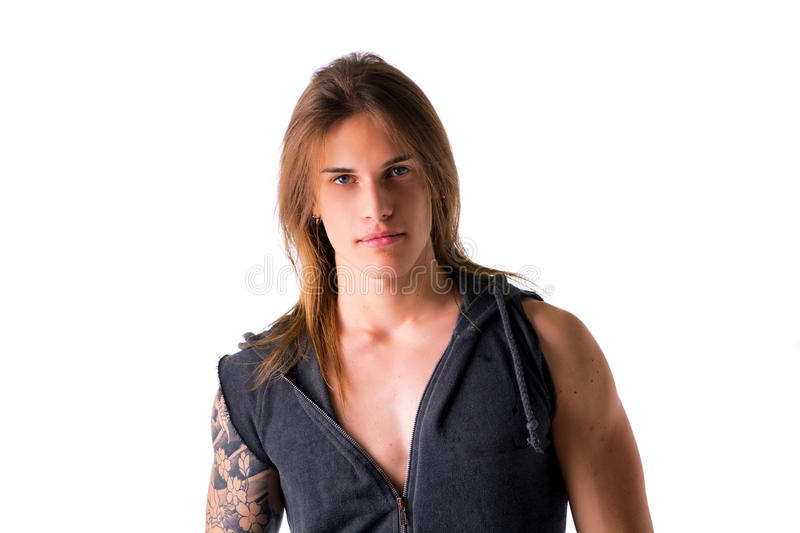 Beautiful young long haired man in jacket posing stock images