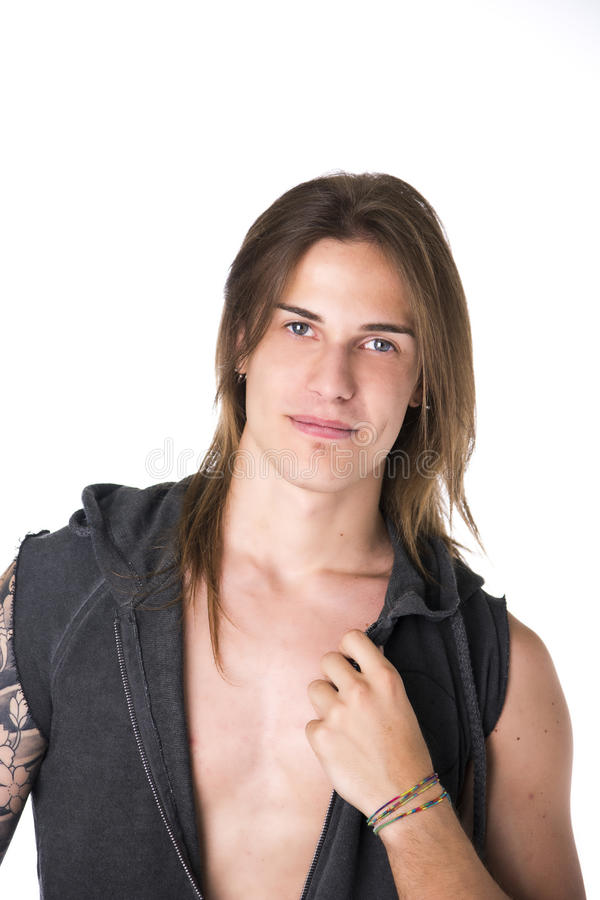 Beautiful young long haired man in jacket posing and smiling. Beautiful young long haired man in jacket smiling, posing isolated on white royalty free stock photos