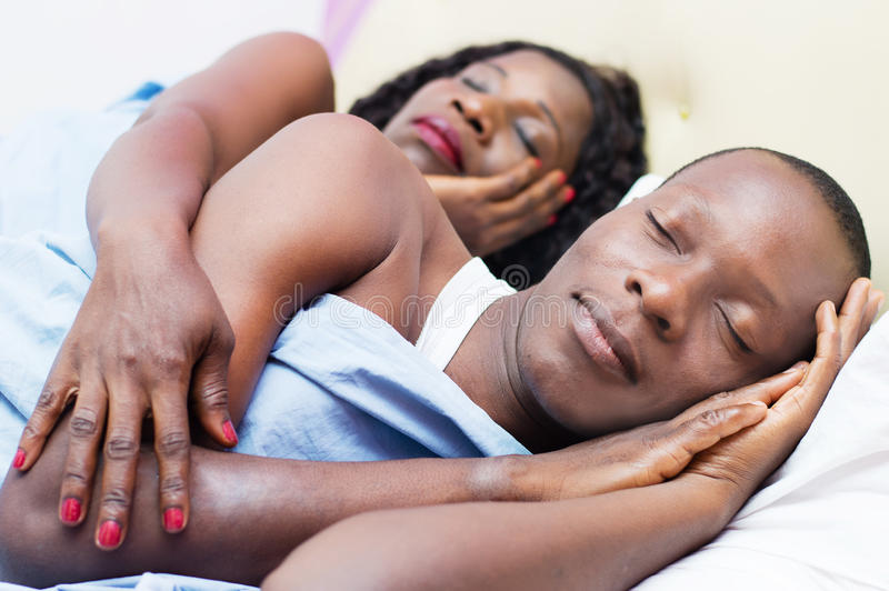 Beautiful young loving couple sleeping together royalty free stock photo