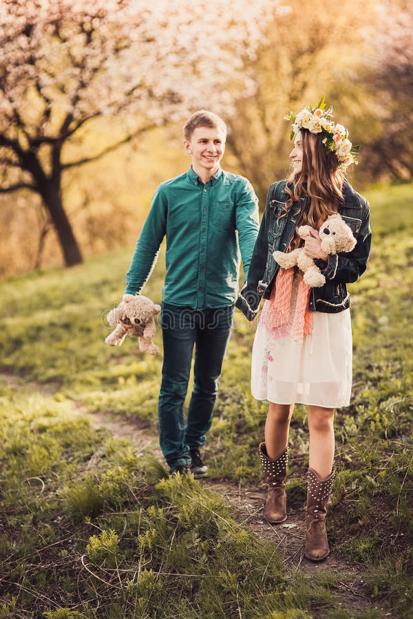 Beautiful young loving couple walking on path royalty free stock images