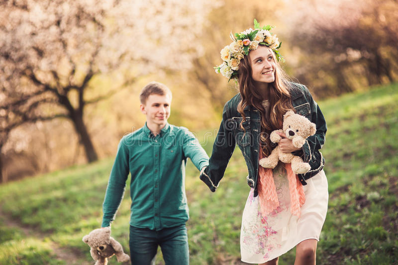 Beautiful young loving couple walking on path royalty free stock photography