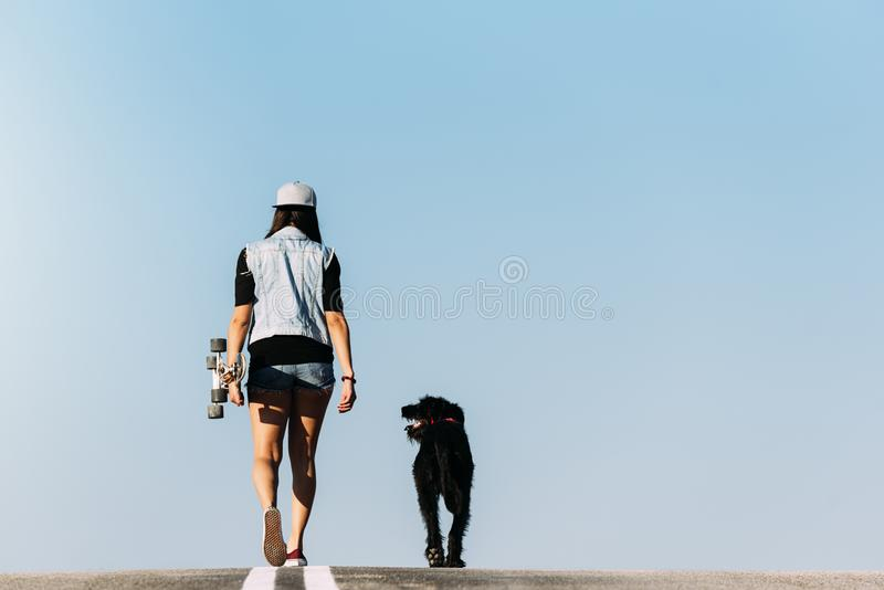 Beautiful young loving her dog. royalty free stock images