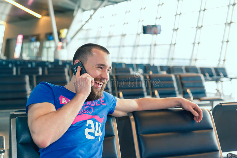 Beautiful young man at the airport royalty free stock photography