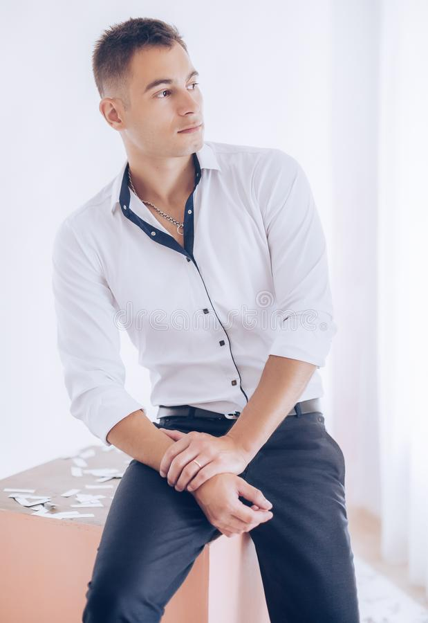 Beautiful young man is wearing a white shir. T. Business style. Stock photo stock images
