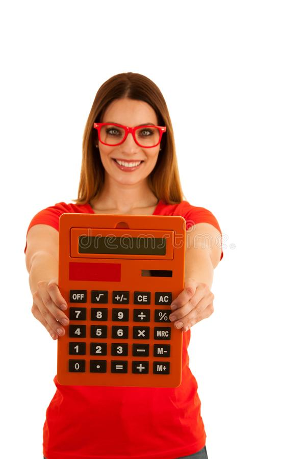Beautiful young math student holds retro big calculator isolated stock image