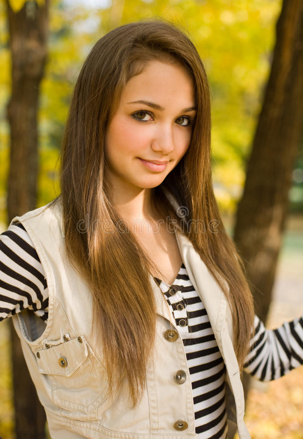 Beautiful young model in the park. stock photography