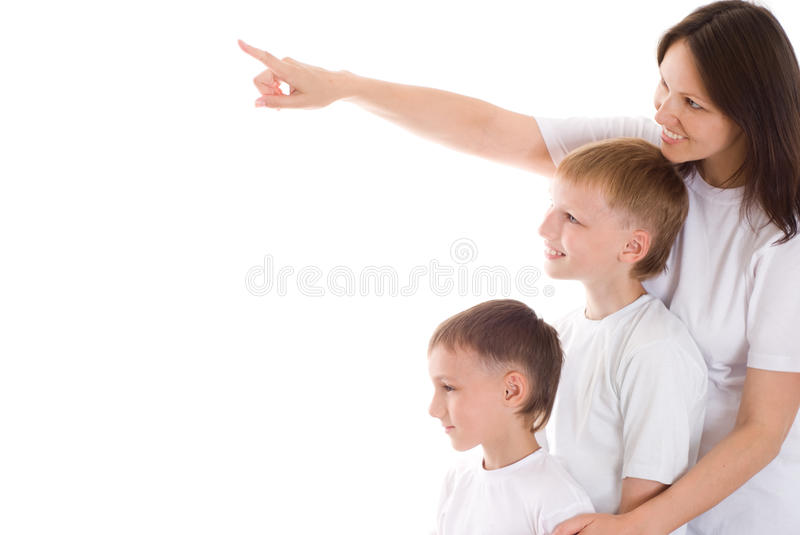 Beautiful young mom standing with her sons. On the white royalty free stock image