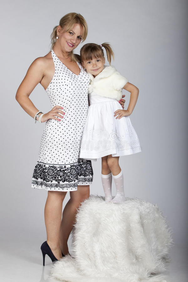 Download Beautiful Young Mother And Daughter Smiling Stock Image - Image of female, cheerful: 16248799