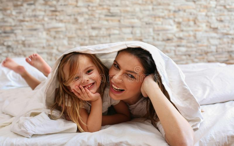 Beautiful young mother with her cute little daughter. stock photos