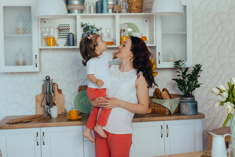 Mom and daughter in the kitchen royalty free stock image