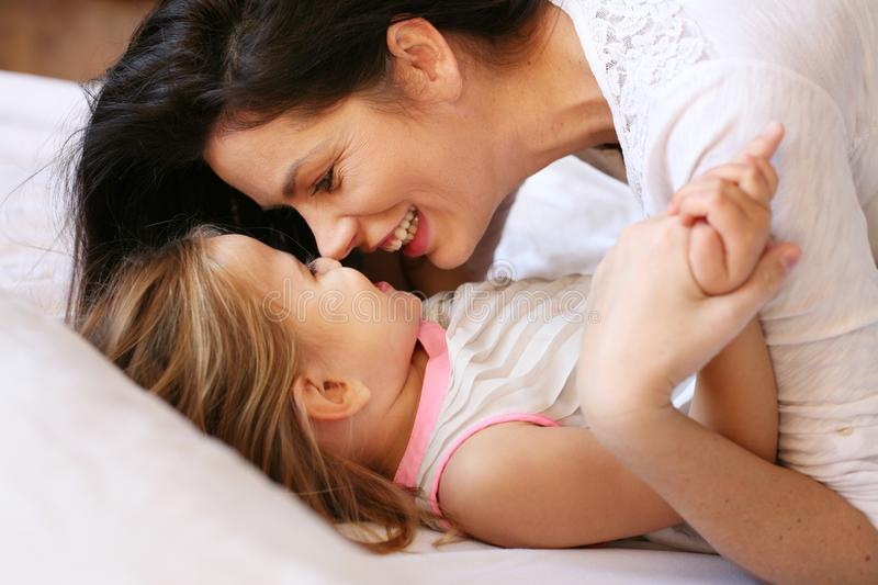 Beautiful young mother and her daughter. royalty free stock photo