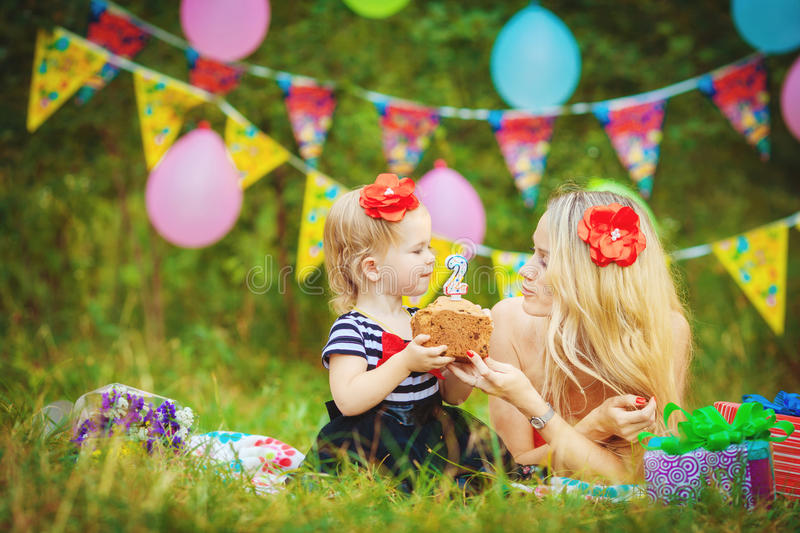 Download Beautiful Young Mother And Her Daughter In The Park Stock Image - Image of joyful, people: 36255237