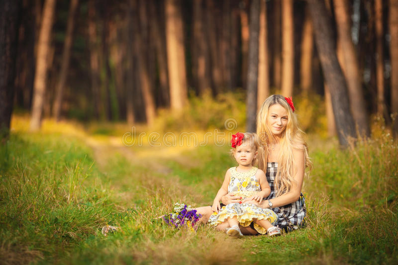 Download Beautiful Young Mother And Her Daughter In The Park Royalty Free Stock Photography - Image: 36255247