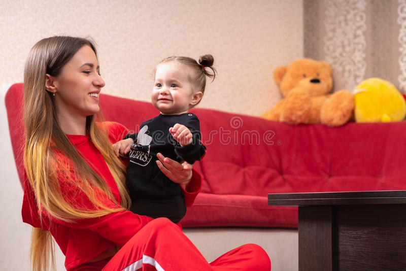 Beautiful young mother holding her baby girl stock photography