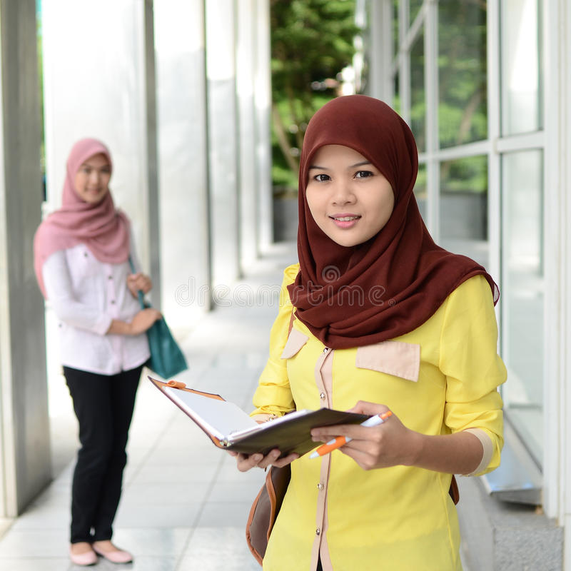Beautiful young muslim student sharing info together stock photos