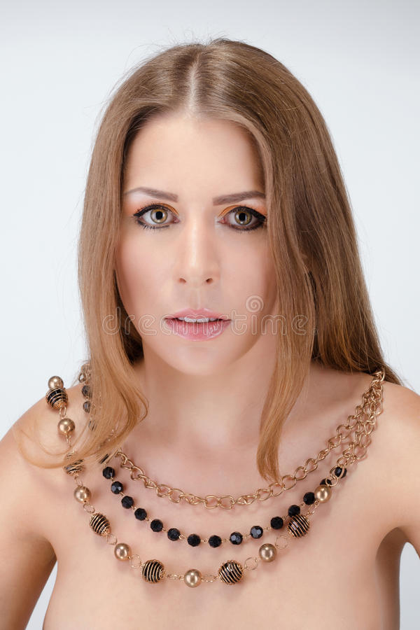 Beautiful Young Naked Woman Wearing Necklace Royalty Free