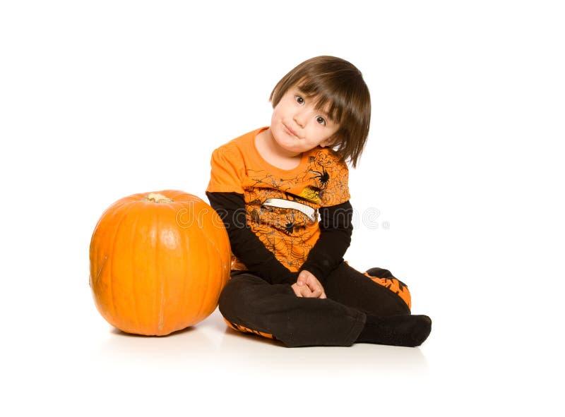 Beautiful young next to Pumpkin stock images