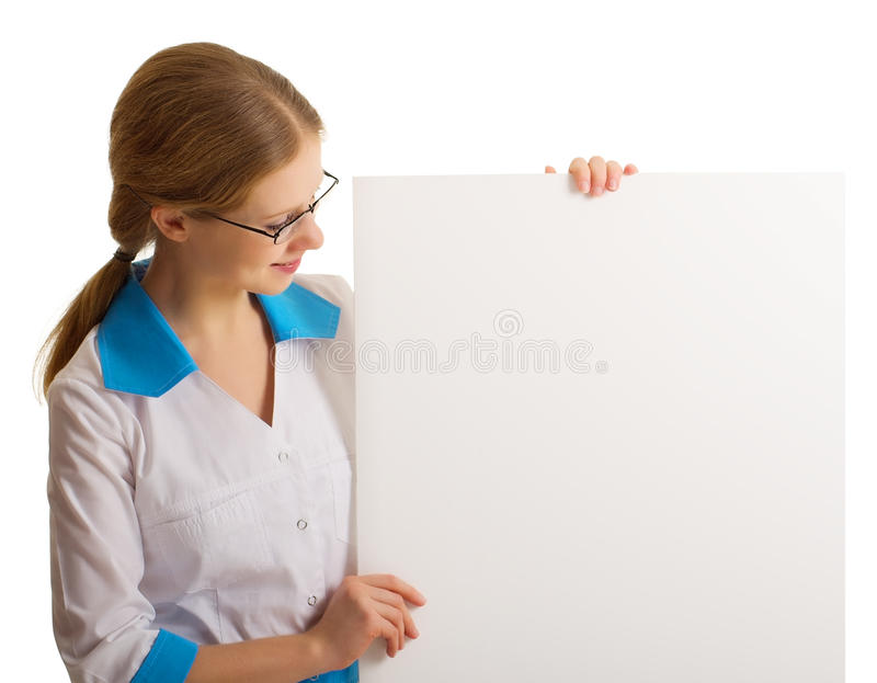 Beautiful young nurse holding a blank banner stock photography