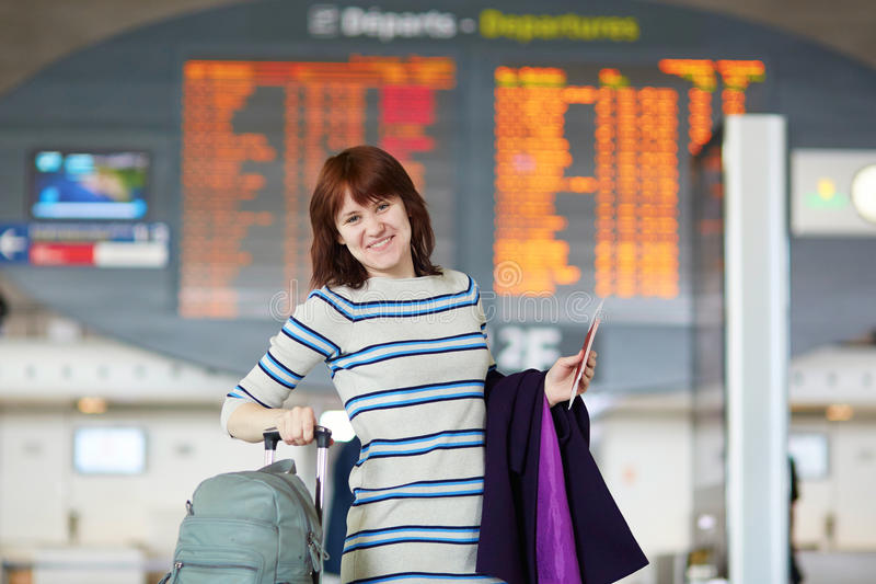 Beautiful young passenger at the airport. Beautiful young female passenger at the airport stock photography