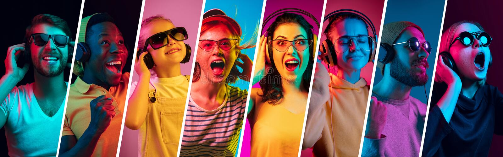 Beautiful young people in neon light isolated on multicolored studio background stock photo