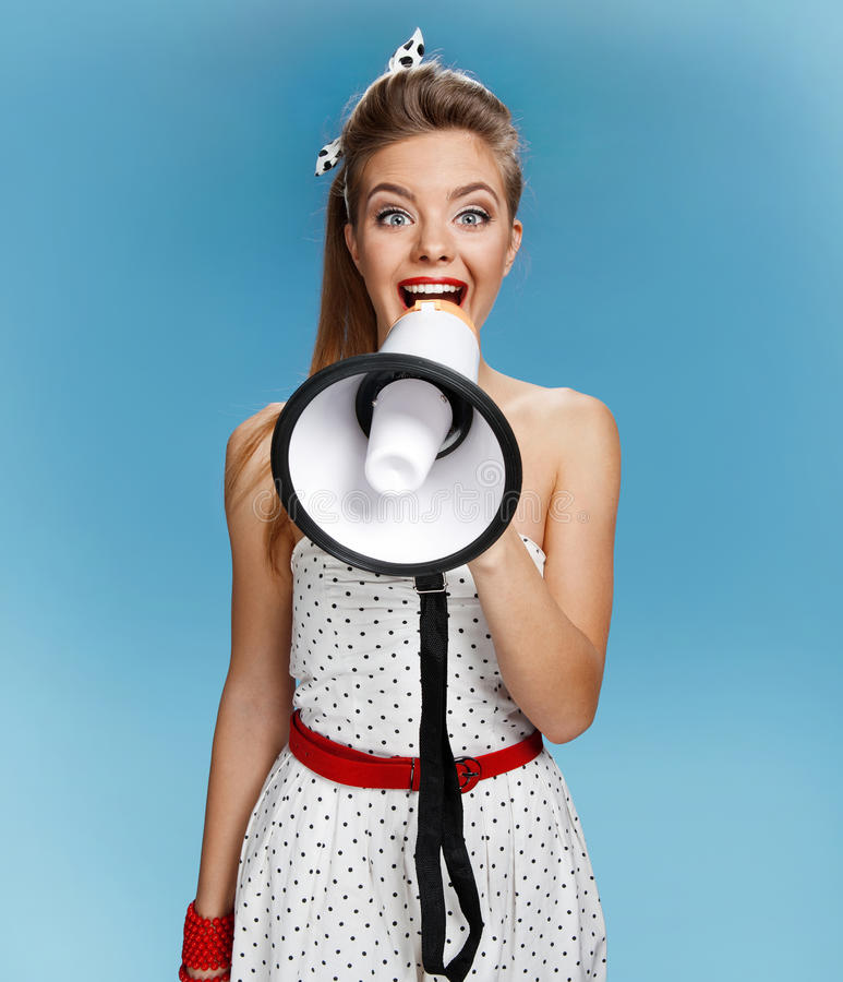 Beautiful young pin-up girl speak in megaphone, mouthpiece, speaking trumpet. Filmmaking or film production concept. Photo set of young American pin-up model on royalty free stock images