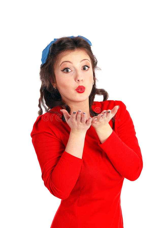 Beautiful young pin-up style model giving an air-kiss over white stock photo