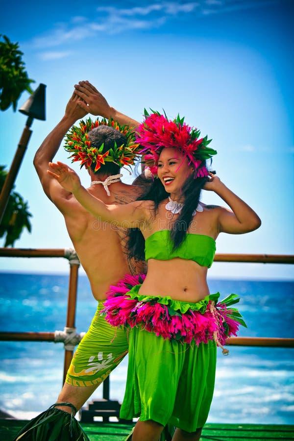 Beautiful young Polynesian woman and man performing traditional Hula dance stock photo